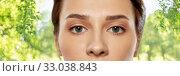 Купить «close up of beautiful young woman face and eyes», фото № 33038843, снято 30 ноября 2019 г. (c) Syda Productions / Фотобанк Лори