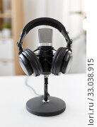 Купить «headphones and microphone at home office», фото № 33038915, снято 17 мая 2019 г. (c) Syda Productions / Фотобанк Лори