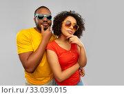 Купить «african couple in sunglasses thinking», фото № 33039015, снято 15 декабря 2019 г. (c) Syda Productions / Фотобанк Лори