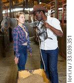 Купить «Couple of farmers discussing with expression», фото № 33039351, снято 2 октября 2018 г. (c) Яков Филимонов / Фотобанк Лори