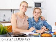Girl and her mother doing home task. Стоковое фото, фотограф Яков Филимонов / Фотобанк Лори