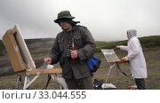 Купить «Two creative artists painting on canvas an easel mountain landscape in cloudy weather in autumn», видеоролик № 33044555, снято 30 августа 2019 г. (c) А. А. Пирагис / Фотобанк Лори