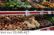 Купить «Colorful market counter with large assortment of fresh fruits and vegetables for sale», видеоролик № 33045427, снято 20 ноября 2019 г. (c) Яков Филимонов / Фотобанк Лори