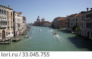 Купить «Scenic view of Venetian Grand Canal with old colorful architecture of central districts and St Mark Campanile in sunny day», видеоролик № 33045755, снято 5 сентября 2019 г. (c) Яков Филимонов / Фотобанк Лори