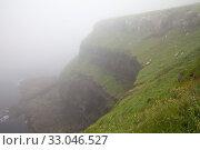 Купить «Steilkueste im Nebel, Vágar, Faeroeer, Føroyar, Daenemark, Europa», фото № 33046527, снято 6 августа 2020 г. (c) age Fotostock / Фотобанк Лори