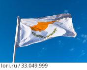 Купить «Flag of the Republic of Cyprus against the blue sky», фото № 33049999, снято 6 октября 2019 г. (c) Володина Ольга / Фотобанк Лори