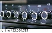 Купить «The front glass panel of the new gas stove is black.», фото № 33050715, снято 3 февраля 2017 г. (c) Акиньшин Владимир / Фотобанк Лори