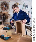 Купить «Man making drawer at workshop», фото № 33051243, снято 7 ноября 2016 г. (c) Яков Филимонов / Фотобанк Лори