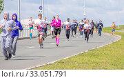 Купить «Russia, Samara, May 2019: a group of young beautiful sports people run around the new stadium at a city event, race.», фото № 33051791, снято 19 мая 2019 г. (c) Акиньшин Владимир / Фотобанк Лори
