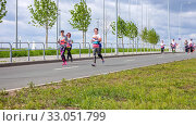 Купить «Russia, Samara, May 2019: a group of young beautiful sports people run around the new stadium at a city event, race.», фото № 33051799, снято 19 мая 2019 г. (c) Акиньшин Владимир / Фотобанк Лори