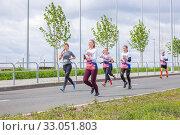 Купить «Russia, Samara, May 2019: a group of young beautiful sports people run around the new stadium at a city event, race.», фото № 33051803, снято 19 мая 2019 г. (c) Акиньшин Владимир / Фотобанк Лори