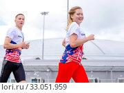 Купить «Russia, Samara, May 2019: beautiful athletic girl runs at the city sports competition, Run.», фото № 33051959, снято 19 мая 2019 г. (c) Акиньшин Владимир / Фотобанк Лори