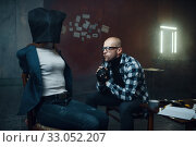 Купить «Maniac kidnapper looks on his female victim», фото № 33052207, снято 13 ноября 2019 г. (c) Tryapitsyn Sergiy / Фотобанк Лори