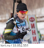 Купить «Korean sportswoman biathlete Lee Hyunju South Korea skiing at finish after rifle shooting during Regional junior biathlon competitions East Cup. Kamchatka Peninsula», фото № 33052551, снято 13 апреля 2019 г. (c) А. А. Пирагис / Фотобанк Лори