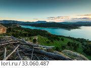 Купить «Sunset over lake in mountains from hill top», фото № 33060487, снято 4 апреля 2020 г. (c) easy Fotostock / Фотобанк Лори