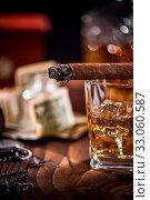 Купить «Cuban cigar and cognac over ice cubes.», фото № 33060587, снято 4 апреля 2020 г. (c) easy Fotostock / Фотобанк Лори