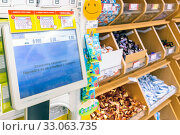 Купить «Russia Samara January 2020: Commercial scales in the confectionery department of self-service Text in Russian: the label is printed, stick it on the package with the goods», фото № 33063735, снято 11 января 2020 г. (c) Акиньшин Владимир / Фотобанк Лори