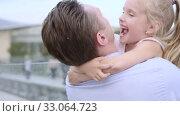Купить «Middle-aged father embraces his daughter. Fair-haired little girl smiles happily», видеоролик № 33064723, снято 29 сентября 2019 г. (c) Ирина Мойсеева / Фотобанк Лори