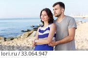 Купить «Happy loving couple standing and hugging», фото № 33064947, снято 27 июня 2018 г. (c) Яков Филимонов / Фотобанк Лори
