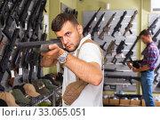 Купить «Men choosing air weapon», фото № 33065051, снято 4 июля 2017 г. (c) Яков Филимонов / Фотобанк Лори