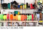 Купить «Colorful ribbons on counter in store», фото № 33065199, снято 18 октября 2019 г. (c) Яков Филимонов / Фотобанк Лори
