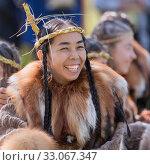 Portrait of expression young woman in clothing aborigine of Kamchatka Peninsula. Редакционное фото, фотограф А. А. Пирагис / Фотобанк Лори