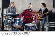 Купить «Rehearsal of music group with male drummer», фото № 33067907, снято 26 октября 2018 г. (c) Яков Филимонов / Фотобанк Лори