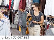 Купить «Woman shopping in clothing boutique», фото № 33067923, снято 10 октября 2018 г. (c) Яков Филимонов / Фотобанк Лори