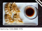 Купить «Japanese tasty dumplings gyozas with soy sauce», фото № 33068115, снято 6 июня 2020 г. (c) Яков Филимонов / Фотобанк Лори