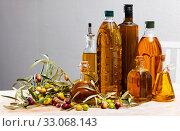 Купить «Different bottles with olive oil and olive branches», фото № 33068143, снято 8 июля 2020 г. (c) Яков Филимонов / Фотобанк Лори