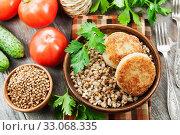 Купить «Buckwheat with burgers», фото № 33068335, снято 27 мая 2019 г. (c) Надежда Мишкова / Фотобанк Лори