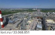 Купить «Flying over facilities of oil-processing plant», видеоролик № 33068851, снято 26 февраля 2020 г. (c) Данил Руденко / Фотобанк Лори