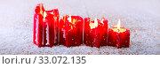 Купить «Four red Avent candles isolated on wood background with snow.», фото № 33072135, снято 2 апреля 2020 г. (c) easy Fotostock / Фотобанк Лори