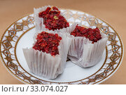 Three slices of fruit barberry lokum on a saucer. Стоковое фото, фотограф ok_fotoday / Фотобанк Лори