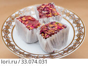 Купить «Three slices of fruit rosary turkish delight on a saucer», фото № 33074031, снято 21 января 2020 г. (c) ok_fotoday / Фотобанк Лори