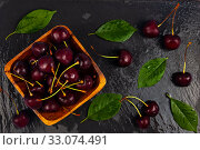 Ripe sweet cherry in a wooden bowl. Стоковое фото, фотограф Елена Блохина / Фотобанк Лори