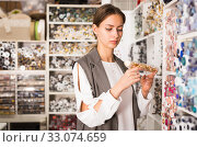 Купить «Seamstress looking for buttons in shop», фото № 33074659, снято 18 октября 2019 г. (c) Яков Филимонов / Фотобанк Лори
