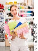 Купить «Delighted woman with ribbons», фото № 33074667, снято 18 октября 2019 г. (c) Яков Филимонов / Фотобанк Лори