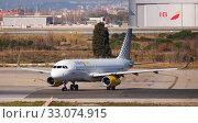 Passenger Airplane of Vueling airlines is preparing for take off. Редакционное фото, фотограф Яков Филимонов / Фотобанк Лори