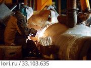 Welder in mask works with metal construction. Стоковое фото, фотограф Tryapitsyn Sergiy / Фотобанк Лори