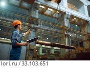 Купить «Master shows thumbs up to crane operator, factory», фото № 33103651, снято 31 января 2020 г. (c) Tryapitsyn Sergiy / Фотобанк Лори