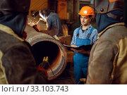 Купить «Master and crew of welders works on factory», фото № 33103743, снято 31 января 2020 г. (c) Tryapitsyn Sergiy / Фотобанк Лори