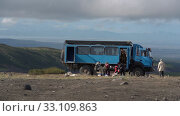 Купить «Group tourists unloads off-road extreme expedition truck in mountains for vacation in popular travel destinations. Kamchatka Peninsula. Time lapse», видеоролик № 33109863, снято 30 августа 2019 г. (c) А. А. Пирагис / Фотобанк Лори