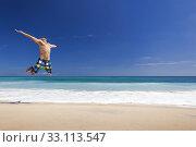 Купить «Man jumping on the beach», фото № 33113547, снято 10 июля 2020 г. (c) PantherMedia / Фотобанк Лори