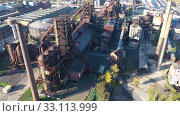 Купить «Aerial view of old rusty facilities of closed metallurgical plant in Vitkovice district of Ostrava city, Czech Republic», видеоролик № 33113999, снято 17 октября 2019 г. (c) Яков Филимонов / Фотобанк Лори
