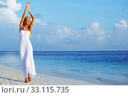 Купить «Woman in white on beach», фото № 33115735, снято 20 сентября 2011 г. (c) Иван Михайлов / Фотобанк Лори