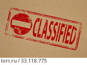 Купить «Classified rubber stamp symbol on brown paper background.», фото № 33118775, снято 9 апреля 2020 г. (c) PantherMedia / Фотобанк Лори