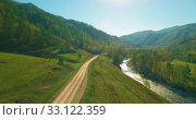 Купить «Low altitude flight over fresh fast mountain river with rocks at sunny summer morning.», видеоролик № 33122359, снято 10 апреля 2019 г. (c) Александр Маркин / Фотобанк Лори