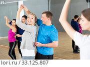 Mature blonde dancing slow ballroom dance in pair. Стоковое фото, фотограф Яков Филимонов / Фотобанк Лори