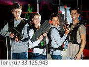 Купить «Friends playing lasertag game», фото № 33125943, снято 25 февраля 2020 г. (c) Яков Филимонов / Фотобанк Лори